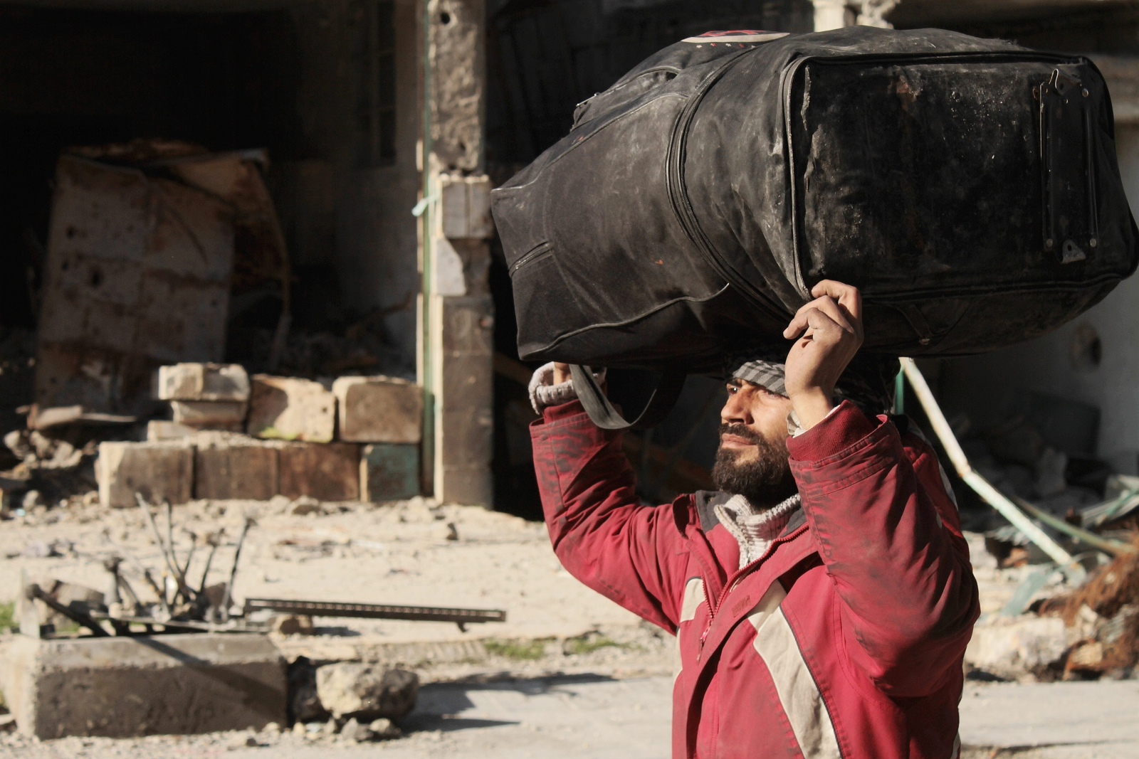 Trwa ewakuacja Aleppo. Fot. PAP/EPA/GHITH SY