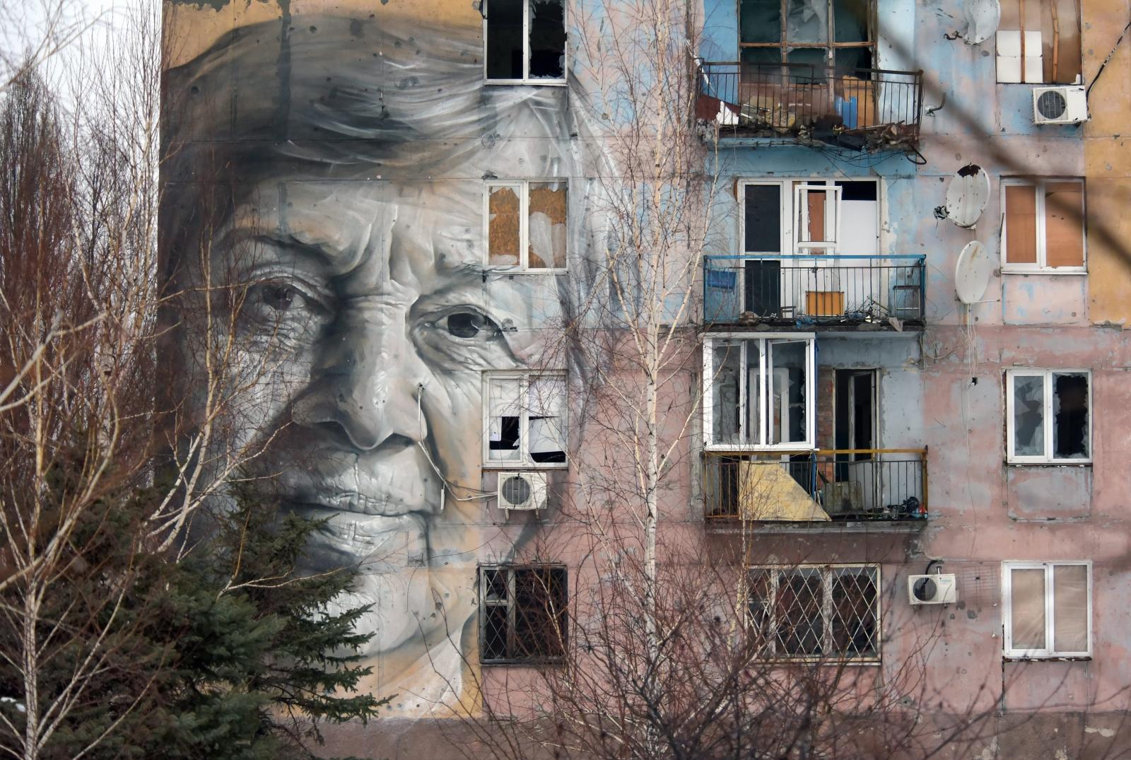 Portret ukraińskiej nauczycielki wykonany przez australijczyka Guido Van Heltena w Doniecku, Ukraina.