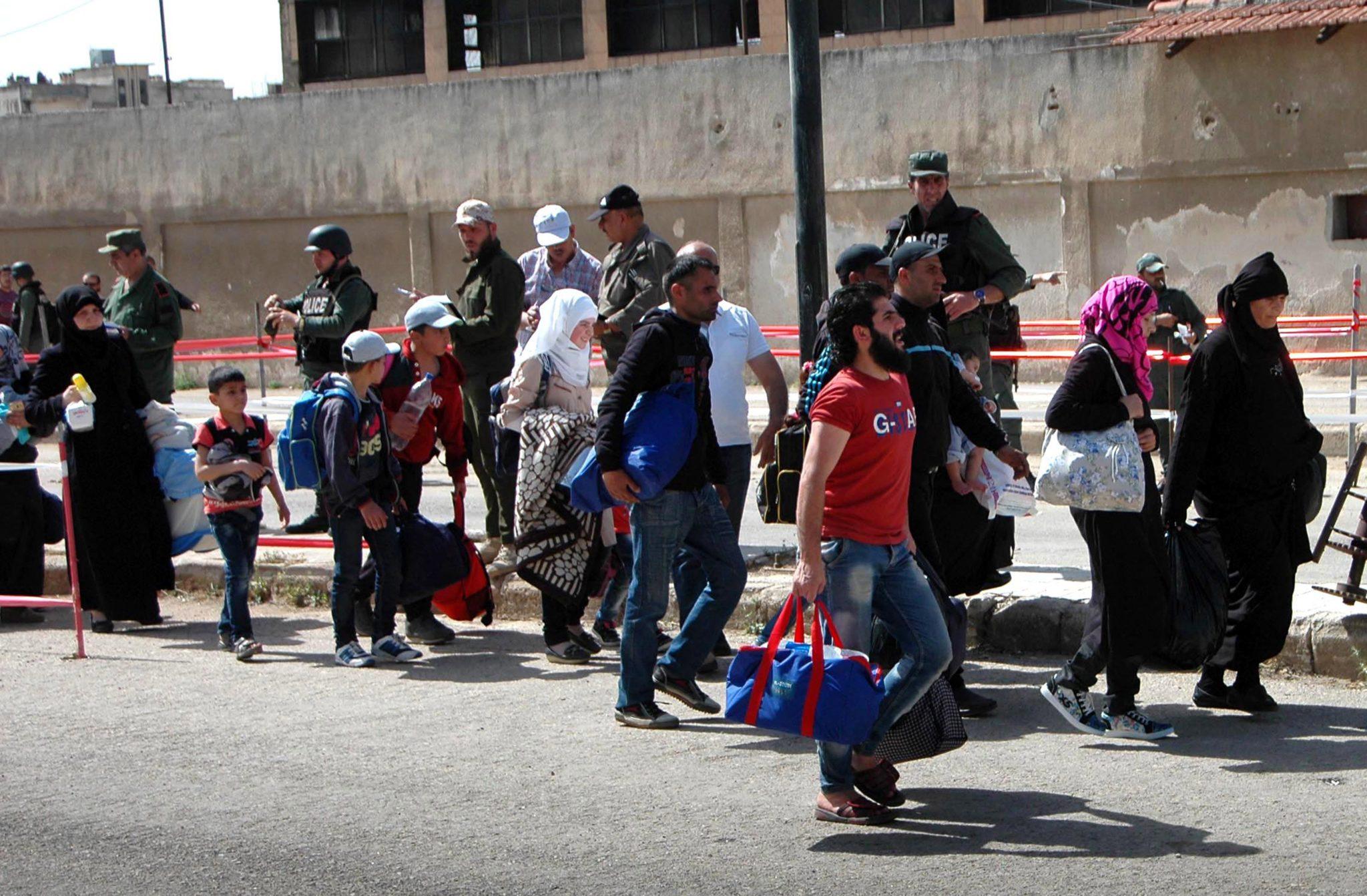 Syria: ewakuacja ludności cywilnej z Homs (foto. PAP/ EPA/SANA)