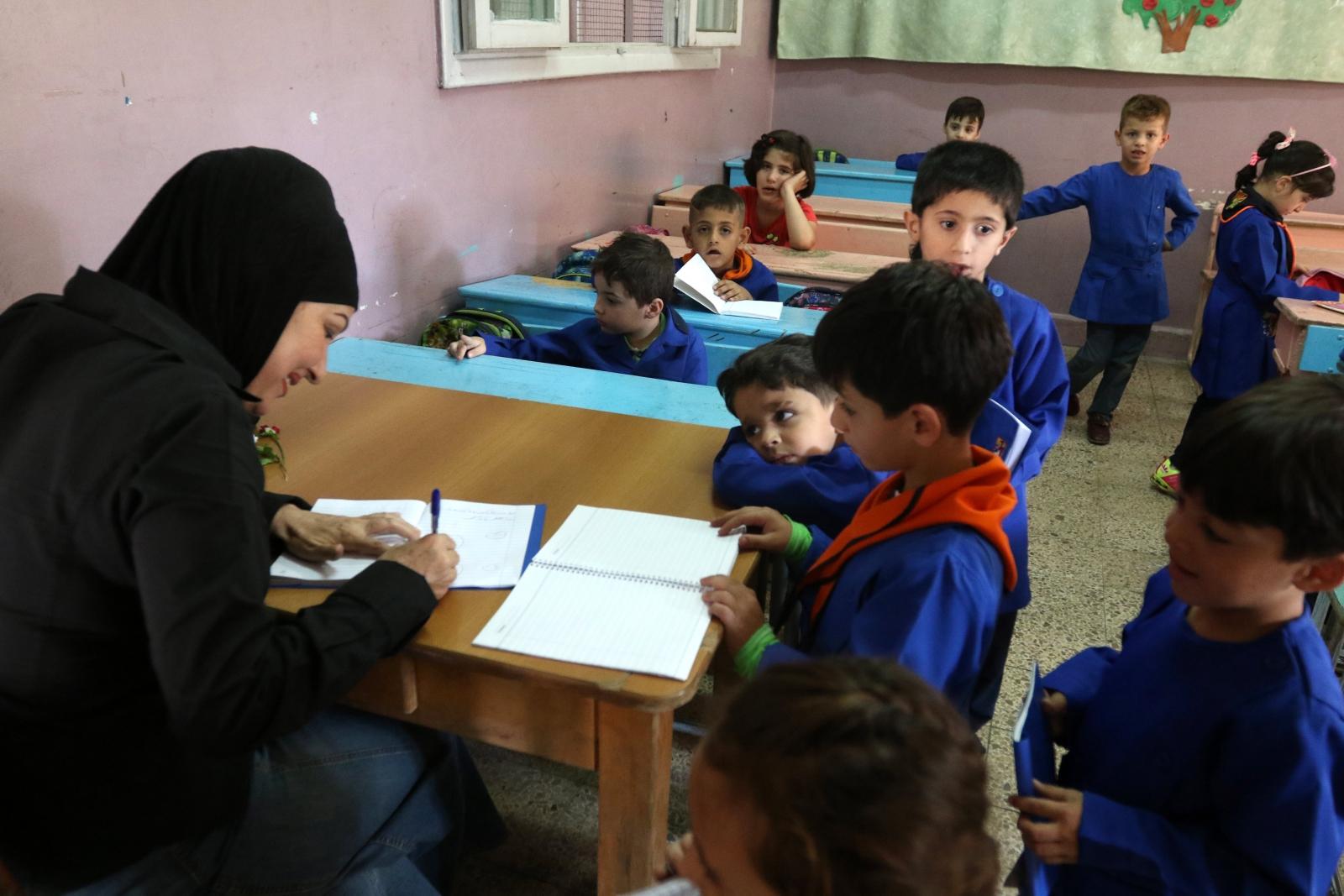 Syria - uczniowie rozpoczęli naukę EPA/YOUSSEF BADAWI
