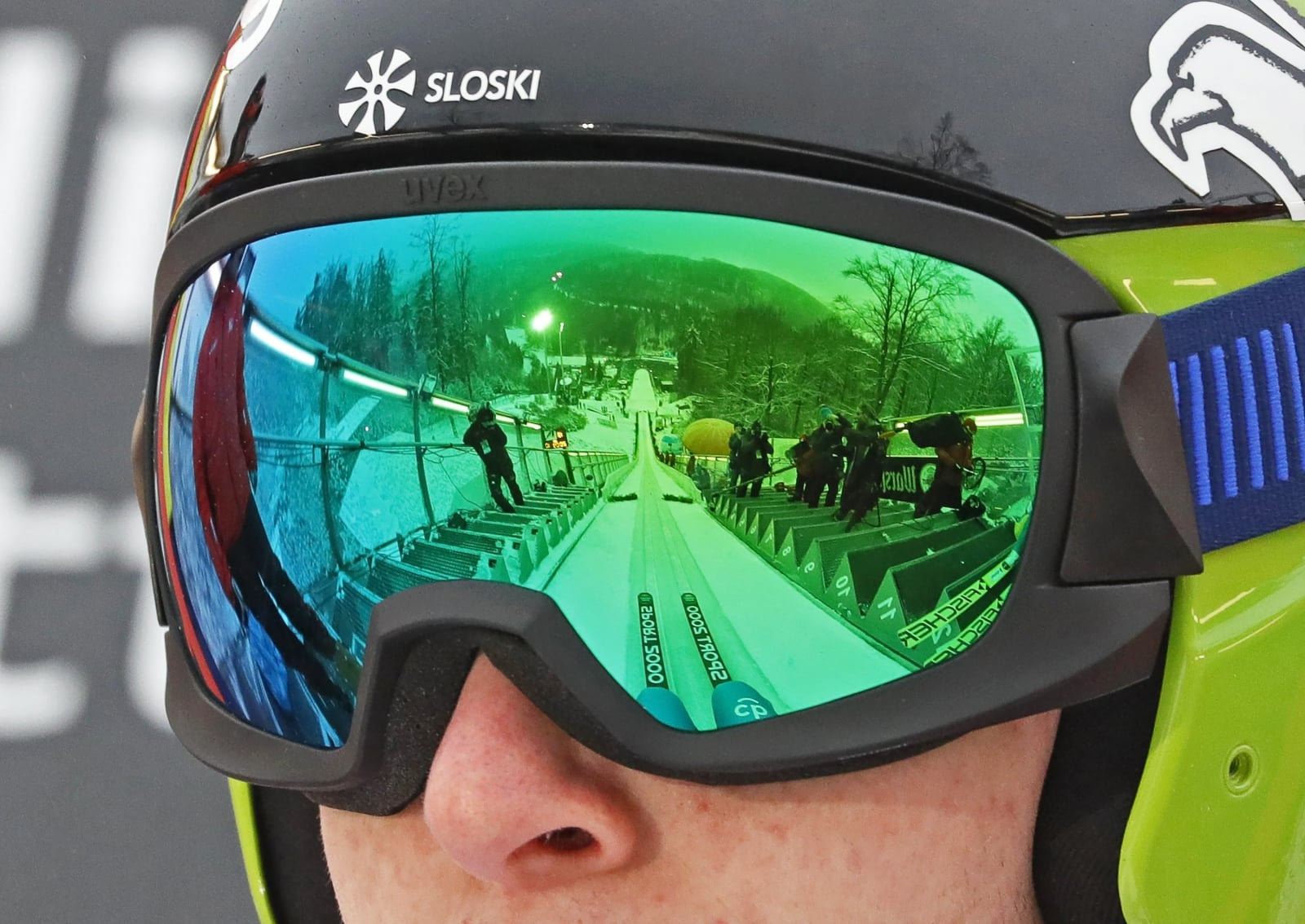 epa06492606 The Muehlenkopf ski jumping hill is reflected in the glasses of Ziga Jelar of Slovenia during a trial round of the FIS Ski Jumping World Cup in Willingen, Germany, 02 February 2018.  EPA/RONALD WITTEK Dostawca: PAP/EPA.
