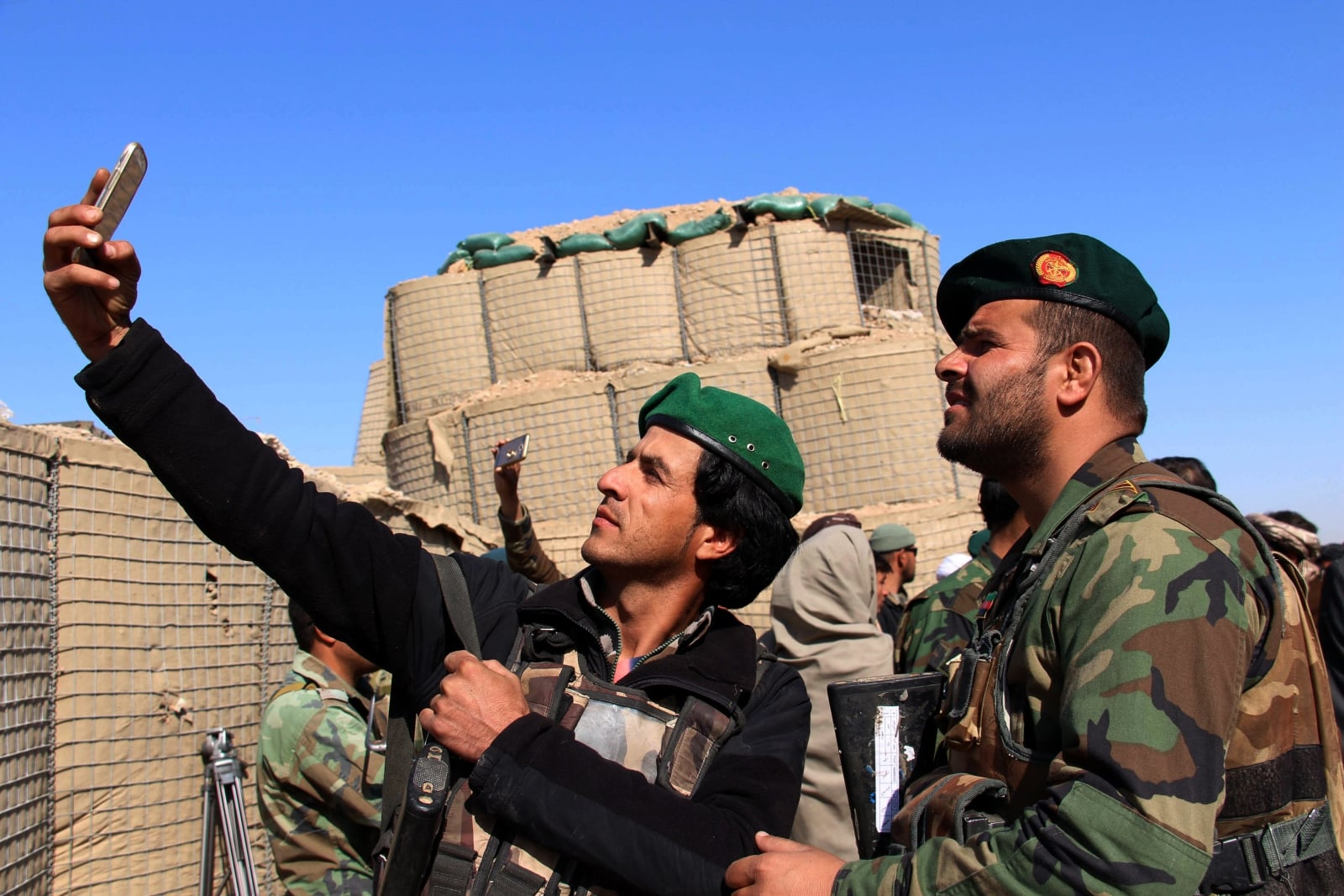 epa06503226 Afghan security forces take selfie as they patrol in Marjah district after they claimed to have cleared the area of Taliban militants, in Helmand, Afghanistan, 07 February 2018. Afghanistan is going through one of its bloodiest periods since the end of the NATO combat mission in 2015, although it continues to be involved in training programs of Afghan forces in the country.  EPA/WATAN YAR Dostawca: PAP/EPA.