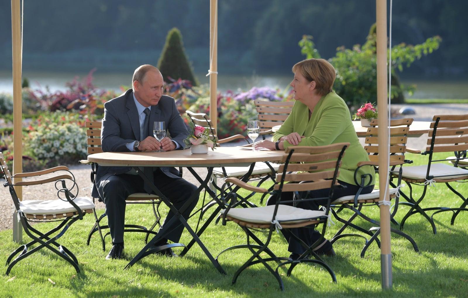 Władimir Putin na spotkaniu z Angelą Merkel w Berlinie. Fot. PAP/EPA/ALEXEI DRUZHININ / SPUTNIK