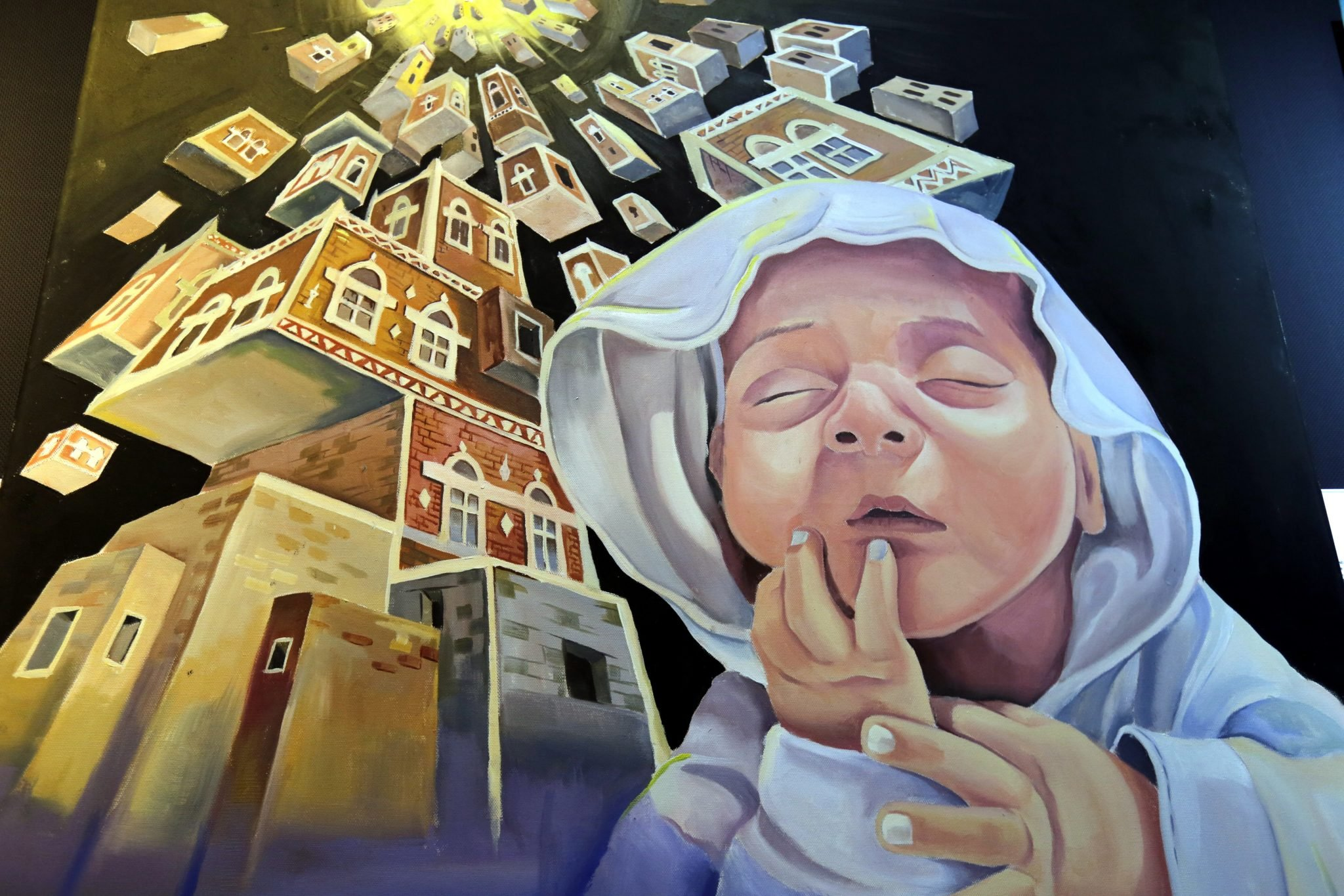 Galeria w Sanie, stolicy Jemenu. Grupa antywojennych artystów stworzyła obrazy, żeby zilustrować wpływ wojny na Jemeńczyków, fot. Yahya Arhab, PAP/EPA