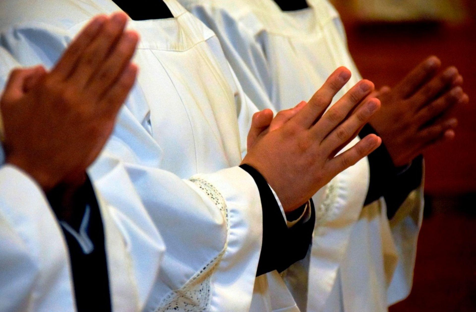 księża