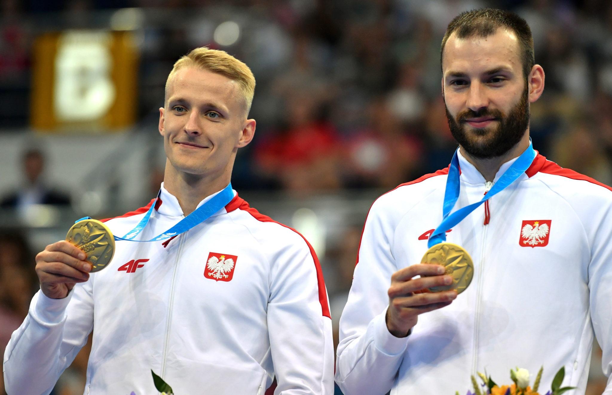 Polacy Łukasz Jaworski i Artur Zakrzewski zdobyli zloty medal w skokach synchronicznych na trampolinie podczas II Igrzysk Europejskich w Mińsk Arenie w Mińsku. To pierwszy medal wywalczony przez biało-czerwonych na tej imprezie, fot. Piotr Nowak, PAP