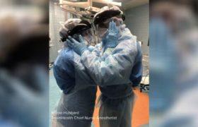 Mąż i żona jednoczą się w walce z pandemią. To zdjęcie obiegło świat