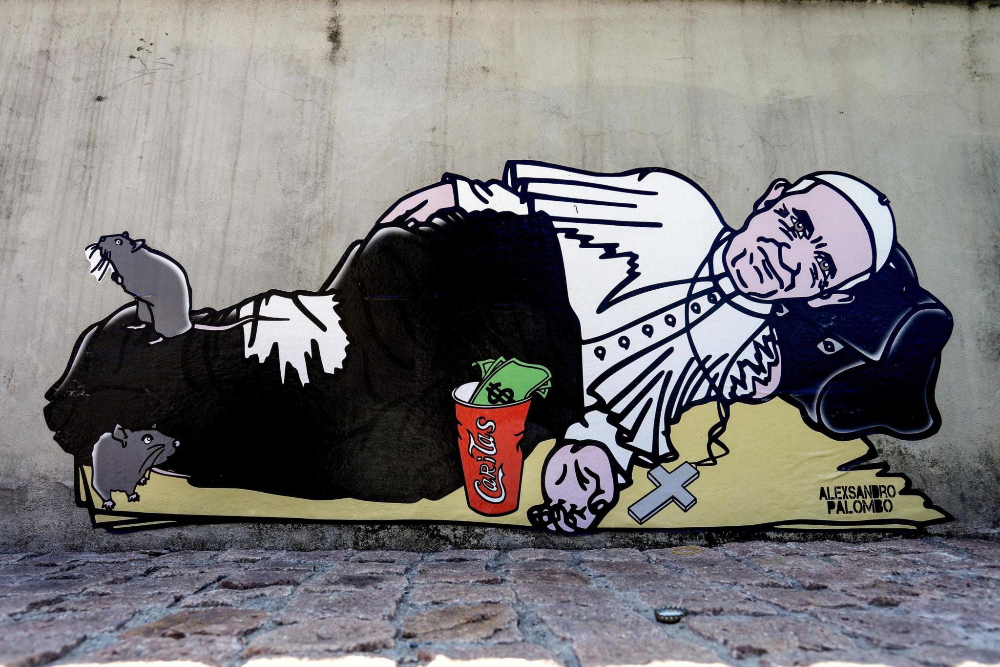 Mural przedstawiający papieża jako żebraka, autorstwa artysty i aktywisty aleXsandro Palombo, na placu Piazza San Gioachimo w Mediolanie, fot. EPA/BALTI TOUATI MOURAD